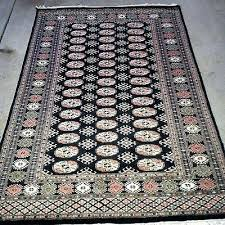 black oriental rug hand knotted wool pile design cream