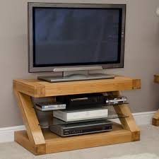 decoration: Well Turned LED TV Above DVD Player And Books On Glass Layer  Fit To