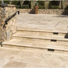Travertine tile by the pool creates a beautiful finished look.