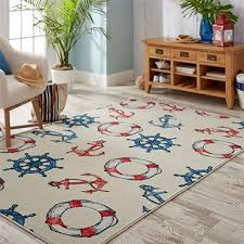 red white and blue floats anchors and oars come together in the nautical inspired style of mohawk homes coastal life area rug in linen