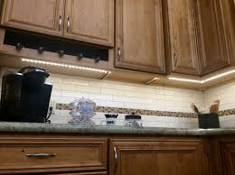 classic kitchen wood cabinet design with sparkling coolest seagull under cabinet lighting led track light design combined with white smart backsplash tile
