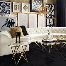 French living room boasts a gold leaf coffee table with a sleek white sofa against black frame windows fitted with ivory pleat curtains. Rbglr41 Ideas Here Rustic Black Gold Living Room Collection 4532