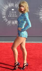 Taylor Swift walking the red carpet. her skin care secrets at.