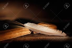 old book with open pages and quill pen on wooden table stock photo 98366538