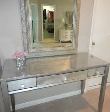 Silver Bedroom Vanity Carved Metal Frame Wall Mirror Above Rectangle Silver Glaze Table
