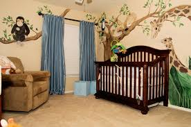 Wonderful Cherry Wood Crib Also Double Blue Sliding Curtain Windows As Well  As Brown Couch As Well As Trees Decals In Natural Baby Boy Room Ideas