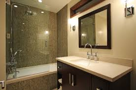 view in gallery beautiful modern bath that combines shower and the bathtub behind glass doors