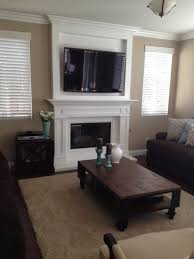 tv cabinet over fireplace mantel contemporary