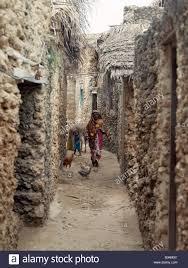 Kenya, Pate Island, Pate Village. A typical street scene in one of ...