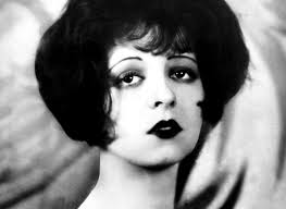 1920s era team your emphasized heavy dark eye makeup hair worn up and long necklines was