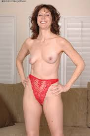 Milf in red dress stripping