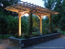 lighting a pergola. contemporary lighting clay paver dinning patio with natural stone raised planter and cedar pergola   uplighting throughout lighting a n