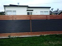 corrugated fence custom privacy fence built out of metal post tiger wood and corrugated metal remodel fence building corrugated metal and privacy fences