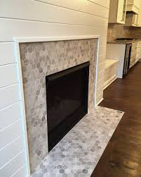 love this hex mosaic tile fireplace surround chenille white hexagon mosaic by daltile light