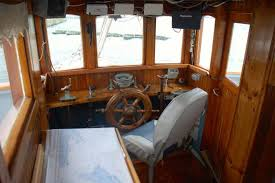 the old fashioned wheelhouse on the sail assisted motor freighter rekord br