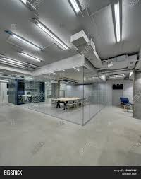 bright office. Bright Office In A Loft Style With Glowing Lamps, Gray Brick Walls And Concrete Columns W