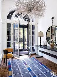 in a boston townhouse designed by wells fox the entrance hall features a chandelier by jean