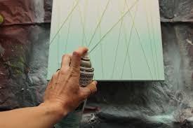 diy abstract art begin spray painting