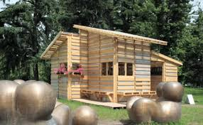 architects suzan wines and azin valy have presented pallet wood homes as the ideal building material for refugee housing in kosovo