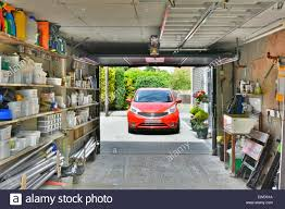 Image Painted Car On Driveway From Inside Garage Attached To House Used For Car Parking Household Storage Of Paraphernalia Tools Garden Sundries Essex England Alamy Car On Driveway From Inside Garage Attached To House Used For Car