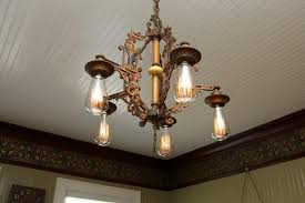 antique light fixture in dining room