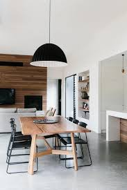 built in bookshelf raised ceiling in dining lounge timber feature wall to soften polished concrete floor the style files