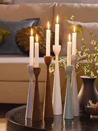 Decorative candles and wooden candle holders for cozy interior decorating  in vintage style