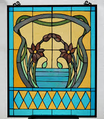 art nouveau style stained glass window with hanging eyes glass stained glass