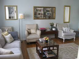 living room blue wall theme and double beige fabric chairs also rectangle brown wooden table