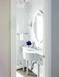 white trellis mirror white vanity powder room a cascading crystal chandelier illuminates walls clad in and