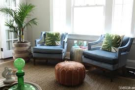 pair of mid century club chairs in blue velvet with leather pouf and palm tree kellyelko