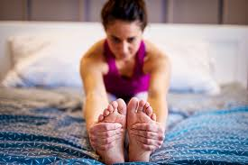 how to practice morning yoga in bed