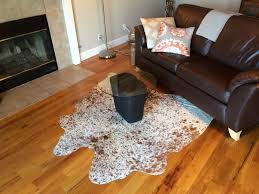 cowhide rug under small accent table