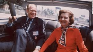 ford president car. united states president gerald ford and wife betty sitting in the back seat of a car