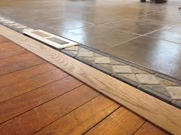 threshold tile to wood floor in open concept living room and kitchen