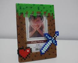17 best images about minecraft perler beads perler minecraft grass block heart and sword picture frame perler beads by allpixelsandthings