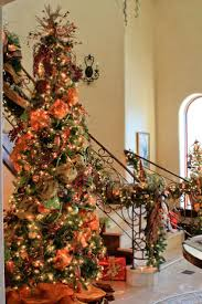 Christmas tree and stairway garland...complete with orange moire and  Burgundy velvet ribbon