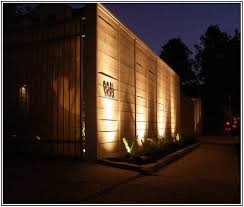 modern exterior lighting. the lighting is installed in bottom of fencing and directs powerful light upward making your exterior so nice modern