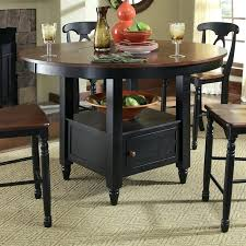 a tish isles round counter height dining table with lazy storage base high top wine home