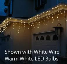 Pure White LED Icicle Lights on Green Wire - Novelty Lights Inc