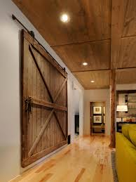 barn doors for homes interior. Great Wide Reclaimed Wooden Sliding Interior Barn Doors For Homes With Green Couch Also Vintage Furnishings Living Room Decors