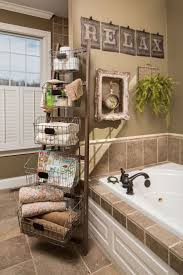 Old ladder used as shelving and towel holder.
