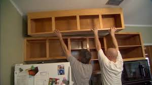 how to take advantage of wasted space above kitchen cabinets today s homeowner