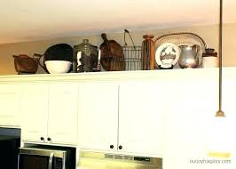 over kitchen cabinet decor top of kitchen cabinet decor greenery above kitchen cabinets gorgeous decorating above