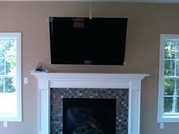 tv mounted above fireplace cable box hide wires hanging over without studs