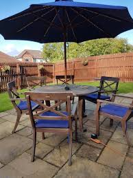 garden wooden table 6 chairs cushions parasol with lights