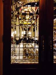 the driskill leaded glass door by valet