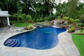 Backyard Swimming Pool With Boulder Waterfall Design Bergen