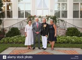 From left, Polly Spencer, Richard V. Spencer, Secretary of the Navy,  Commandant of the Marine Corps Gen. Robert B. Neller, and D'Arcy Neller  pose for a photo before an evening parade at
