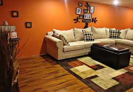 basement wall paintBright Orange Basement Wall Paint Combined With Light Brown